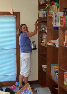 Teacher Judy getting the Sunday School classroom ready for Kids Prime Time.